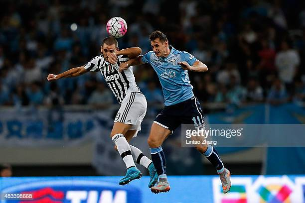 Leonardo Bonucci of Juventus FC head ball with Miroslav Klose of Lazio during the Italian Super Cup final football match between Juventus and Lazio...