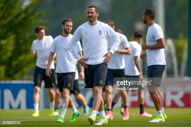 Leonardo Bonucci of Juventus FC leads a group during a training session on the eve of the UEFA Champions League football match between FC Barcelona...