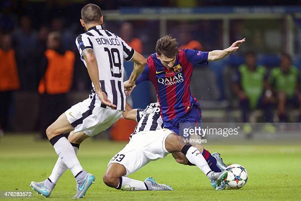 Leonardo Bonucci of Juventus FC Patrice Evra of Juventus FC Lionel Messi of FC Barcelona during the UEFA Champions League final match between...