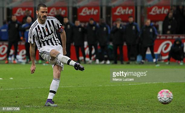Leonardo Bonucci of Juventus FC scores his decisive penalty during the TIM Cup match between FC Internazionale Milano and Juventus FC at Stadio...