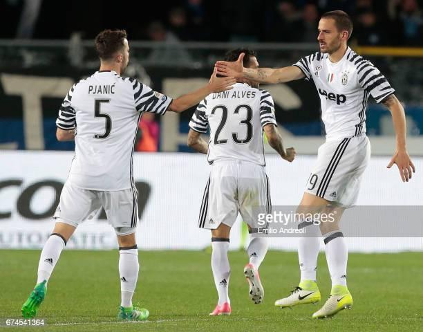 Leonardo Bonucci of Juventus FC with his teammate Miralem Pjanic celebrate after Leonardo Spinazzola of Atalanta BC scored a selfgoal during the...