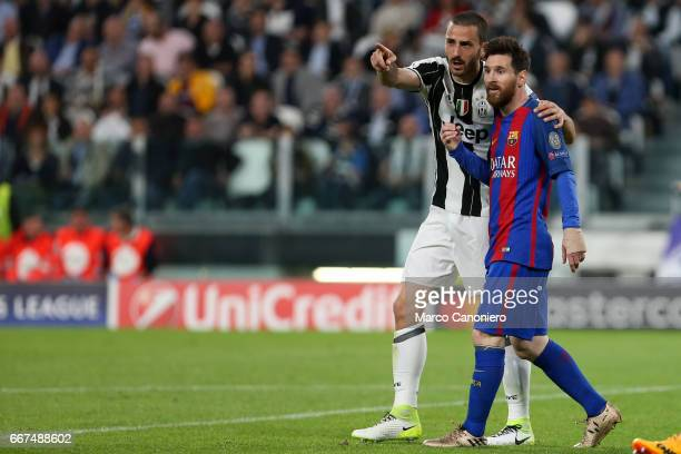 Leonardo Bonucci of Juventus FC with Lionel Messi during the UEFA Champions League quarter final first leg match between Juventus FC and Fc Barcelona