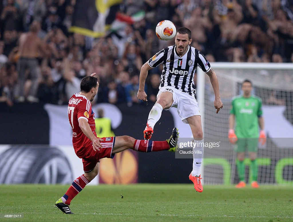 Leonardo Bonucci of Juventus (R) in action during the UEFA Europa League quarter final match between Juventus and Olympique Lyonnais at Juventus Arena on April 10, 2014 in Turin, Italy.