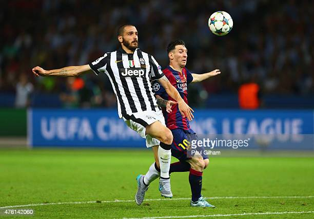 Leonardo Bonucci of Juventus is challenged by Lionel Messi of Barcelona during the UEFA Champions League Final between Juventus and FC Barcelona at...