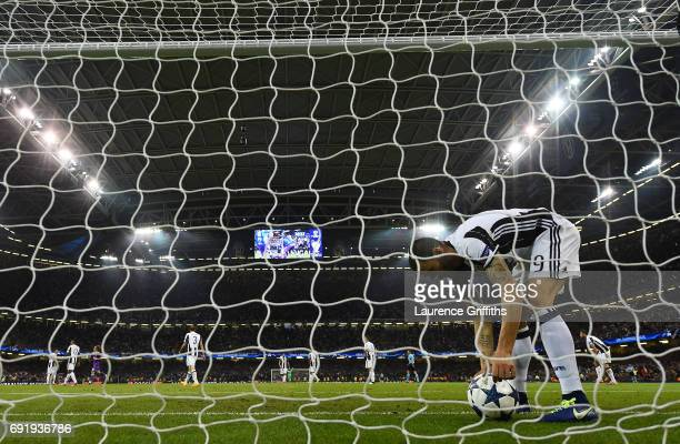 Leonardo Bonucci of Juventus picks the ball out of the net during the UEFA Champions League Final between Juventus and Real Madrid at National...