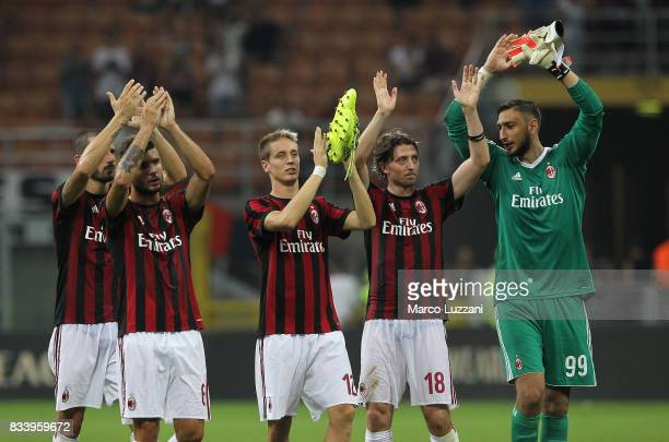 Leonardo Bonucci Patrick Cutrone Andrea Conti Riccardo Montolivo and Gianluigi Donnarumma of AC Milan celebrate a victory at the end of the UEFA...