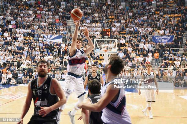 Leonardo Candi of Kontatto competes with Klaudio Ndoja and Andrea Michelori and Marco Spissu of Segafredo during the LegaBasket LNP of serie A2 match...