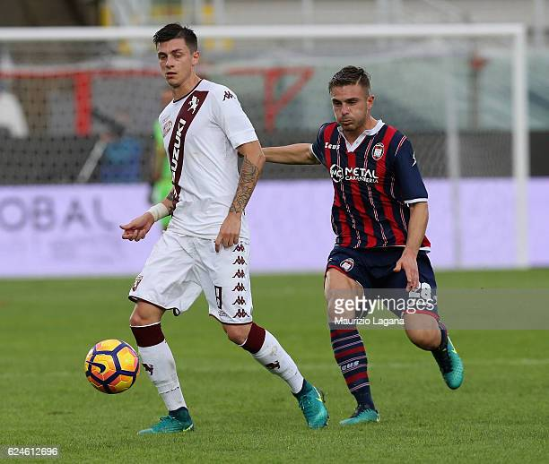 Leonardo Capezzi of Crotone competes for the ball with Daniele Baselli of Torino during the Serie A match between FC Crotone and FC Torino at Stadio...