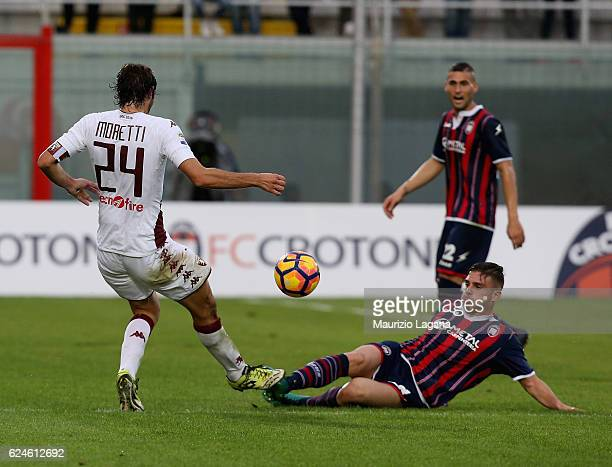 Leonardo Capezzi of Crotone competes for the ball with Emiliano Moretti of Torino during the Serie A match between FC Crotone and FC Torino at Stadio...