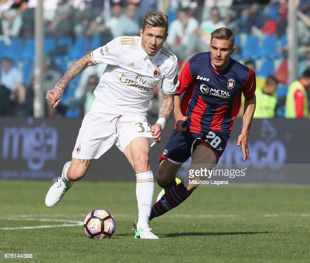 Leonardo Capezzi of Crotone competes for the ball with Juraj Kucka of Milan during the Serie A match between FC Crotone and AC Milan at Stadio...