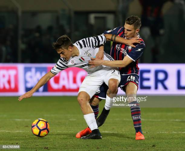 Leonardo Capezzi of Crotone competes for the ball with Paulo Dybala of Juventus during the Serie A match between FC Crotone and Juventus FC at Stadio...