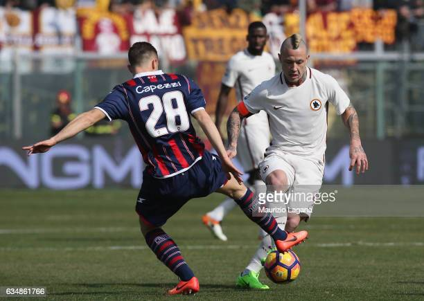 Leonardo Capezzi of Crotone competes for the ball with Radja Nainggolan of Roma during the Serie A match between FC Crotone and AS Roma at Stadio...