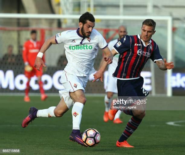 Leonardo Capezzi of Crotone competes for the ball with Riccardo Saponara of Fiorentina during the Serie A match between FC Crotone and ACF Fiorentina...
