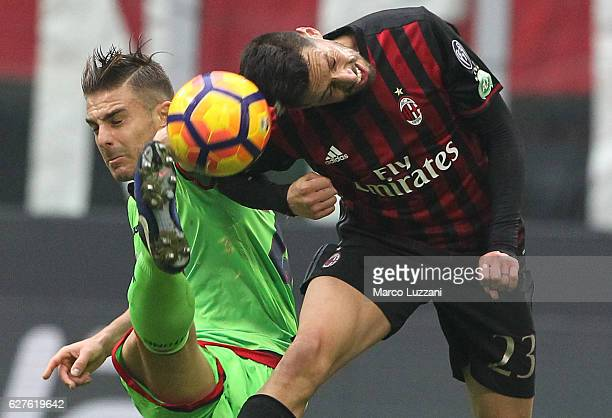 Leonardo Capezzi of FC Crotone competes for the ball with Jose Sosa of AC Milan during the Serie A match between AC Milan and FC Crotone at Stadio...