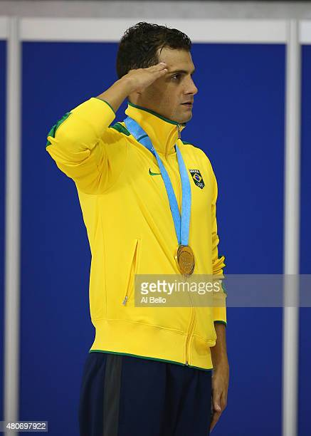Leonardo DeDeus of Brazil shows his Gold Medal after winning the men's 200m finals at the Pan Am Games on July 14 2015 in Toronto Canada