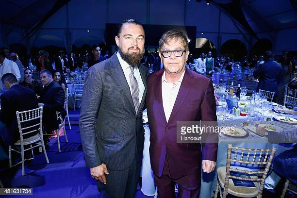 Leonardo DiCaprio and Elton John pose during the Dinner and Auction during The Leonardo DiCaprio Foundation 2nd Annual SaintTropez Gala at Domaine...