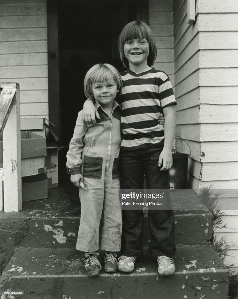 Leonardo DiCaprio (left) and his step-brother Adam Ferrar pose for a portrait outside their home in July 1978 in Hollywood, California