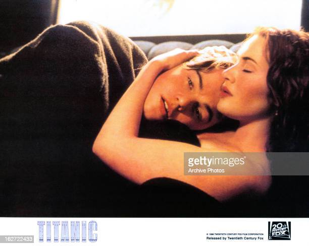 Leonardo DiCaprio and Kate Winslet in bed in a scene from the film 'Titanic' 1997