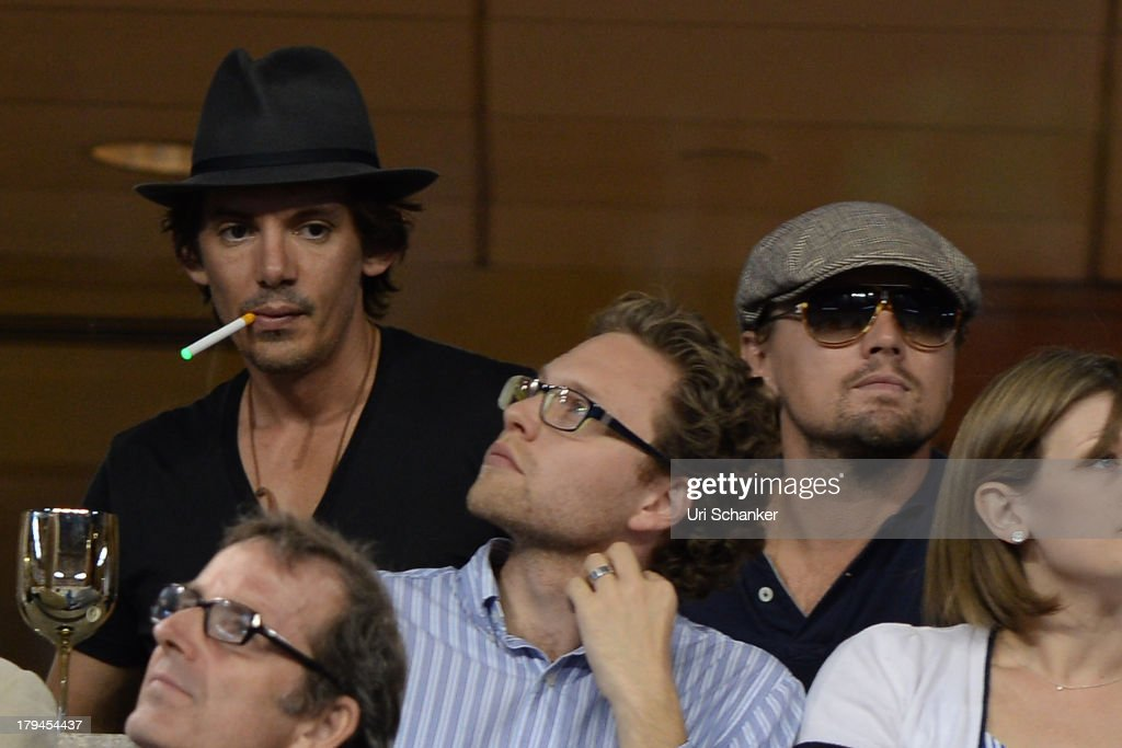Leonardo DiCaprio and Lukas Haas attend the 2013 US Open at USTA Billie Jean King National Tennis Center on September 3, 2013 in New York City.