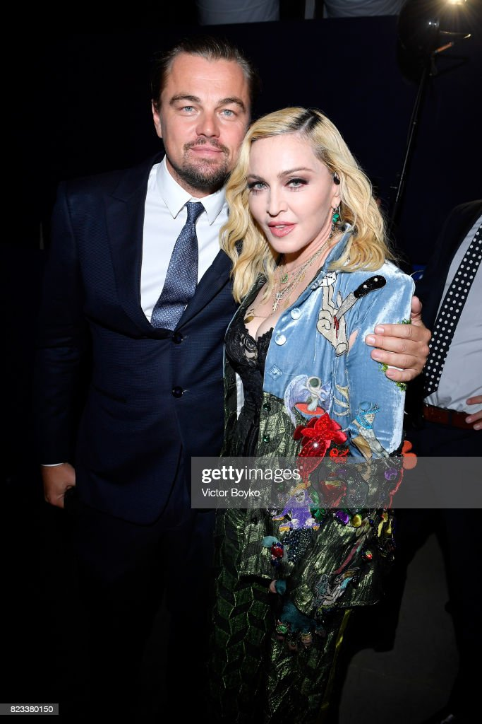 Leonardo DiCaprio and Madonna pose backstage during the Leonardo DiCaprio Foundation 4th Annual Saint-Tropez Gala at Domaine Bertaud Belieu on July 26, 2017 in Saint-Tropez, France.