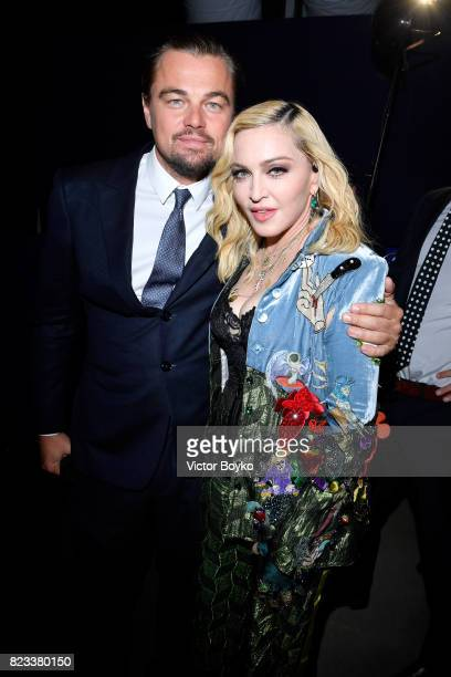 Leonardo DiCaprio and Madonna pose backstage during the Leonardo DiCaprio Foundation 4th Annual SaintTropez Gala at Domaine Bertaud Belieu on July 26...