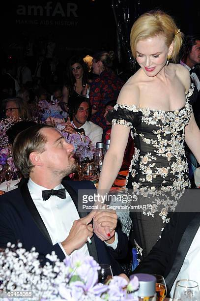 Leonardo DiCaprio (L) and Nicole Kidman attend the Gala Dinner for amfAR's 20th Annual Cinema Against AIDS at Hotel du Cap-Eden-Roc on May 23, 2013 in Cap d'Antibes, France. amfAR sends Leonardo DiCaprio to space. Four guests at amfAR's Cinema Against AIDS gala in Cannes won the chance to fly to space on Virgin Galactic with Leo Dicaprio. This unprecedented experience was organized by amfAR Global Fundraising Ambassador Milutin Gatsby and helped raise $5 million dollars during the record breaking fundraising event which garnered a total of $25 million dollars, making it the most successful amfAR fundraising event in history.