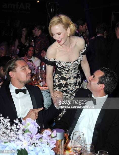 Leonardo DiCaprio (L) and Nicole Kidman (C) attend the Gala Dinner for amfAR's 20th Annual Cinema Against AIDS at Hotel du Cap-Eden-Roc on May 23, 2013 in Cap d'Antibes, France. amfAR sends Leonardo DiCaprio to space. Four guests at amfAR's Cinema Against AIDS gala in Cannes won the chance to fly to space on Virgin Galactic with Leo Dicaprio. This unprecedented experience was organized by amfAR Global Fundraising Ambassador Milutin Gatsby and helped raise $5 million dollars during the record breaking fundraising event which garnered a total of $25 million dollars, making it the most successful amfAR fundraising event in history.