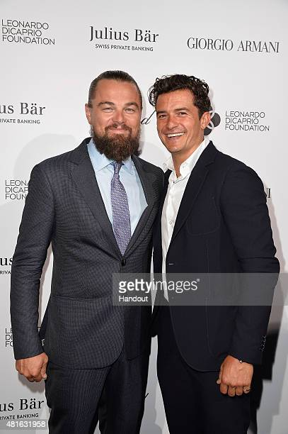 Leonardo DiCaprio and Orlando Bloom attend a cocktail reception during The Leonardo DiCaprio Foundation 2nd Annual SaintTropez Gala at Domaine...