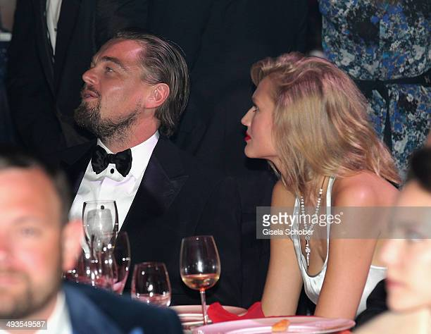 Leonardo DiCaprio and Toni Garrn attend amfAR's 21st Cinema Against AIDS Gala Presented By WORLDVIEW BOLD FILMS And BVLGARI at Hotel du CapEdenRoc on...