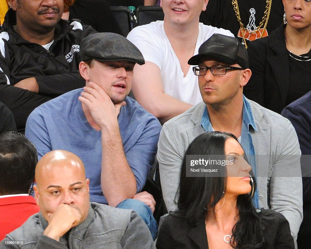 Leonardo DiCaprio (L) attends a basketball game between the Miami Heat and the Los Angeles Lakers at Staples Center on January 17, 2013 in Los Angeles, California.