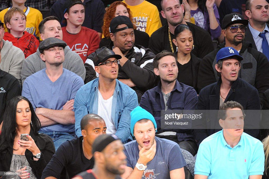 Leonardo DiCaprio, guest, Tobey Maguire and Lukas Haas attend a basketball game between the Miami Heat and the Los Angeles Lakers at Staples Center on January 17, 2013 in Los Angeles, California.