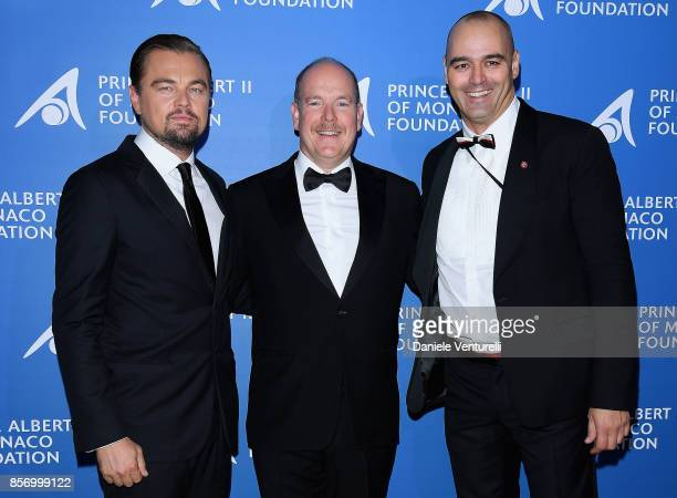 Leonardo DiCaprio Prince Albert II of Monaco and Milutin Gatsby attend the cocktail for the inaugural 'MonteCarlo Gala for the Global Ocean' honoring...