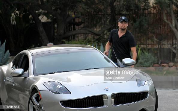 Leonardo DiCaprio seen driving the new 2012 Fisker Karma on August 17 2011 in Los Angeles California When fully charged this plug in hybrid electric...