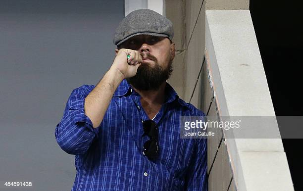 Leonardo DiCaprio smokes an electronic cigarette while watching Djokovic against Murray on Day 10 of the 2014 US Open at USTA Billie Jean King...
