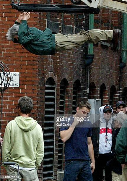 Leonardo DiCaprio walks under a dummy of Martin Sheen on the movie set of 'The Departed' being filmed on Thompson Ally in Boston Massachusetts...