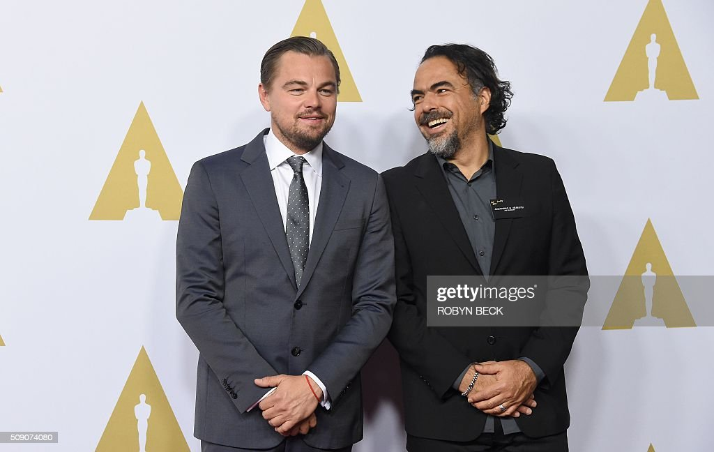 Leonardo DiCaprio(L)nominee for best actor in a leading Role for 'The Revenant' and Alejandro G. Inarritu, nominee for best director for 'The Revenant,' arrive at the 88th Oscar Nominees Luncheon in Beverly Hills, California, February 8, 2016. / AFP / ROBYN BECK