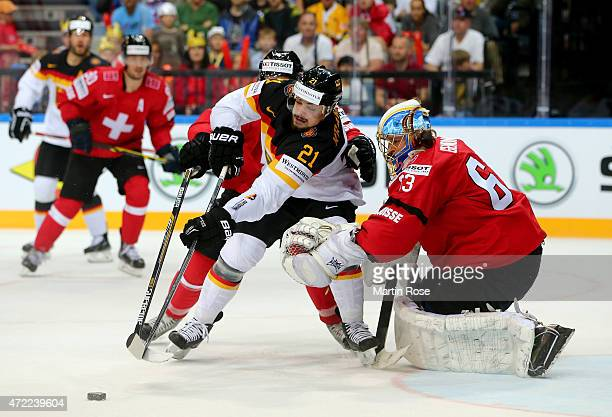 Leonardo Genoni goaltender of Switzerland stops Nicolas Krammer of Germany during the IIHF World Championship group A match between Switzerland and...