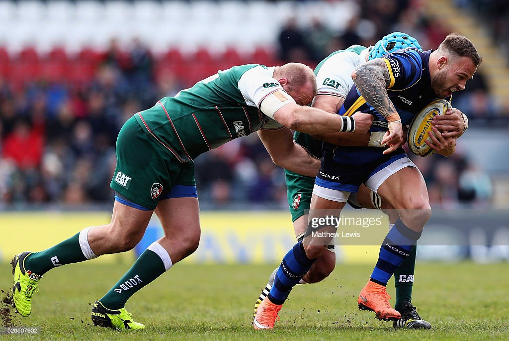 Leonardo Ghiraldini and Graham Kitchener of Leicester Tigers tackle Francois Hougaard of Worcester Warriors during the Aviva Premiership match between Leicester Tigers and Worcester Warriors at Welford Road on April 30, 2016 in Leicester, England.