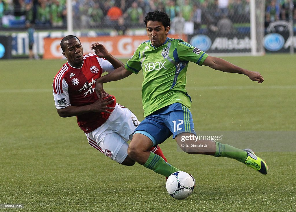 <a gi-track='captionPersonalityLinkClicked' href=/galleries/search?phrase=Leonardo+Gonzalez&family=editorial&specificpeople=554658 ng-click='$event.stopPropagation()'>Leonardo Gonzalez</a> #12 of the Seattle Sounders FC battles <a gi-track='captionPersonalityLinkClicked' href=/galleries/search?phrase=Darlington+Nagbe&family=editorial&specificpeople=6588276 ng-click='$event.stopPropagation()'>Darlington Nagbe</a> #6 of the Portland Timbers at CenturyLink Field on October 7, 2012 in Seattle, Washington. The Sounders defeated the Timbers 3-0.