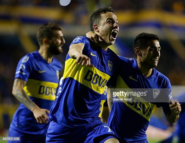 Leonardo Jara and Federico Carrizo of Boca Juniors celebrate after winning a second leg match between Boca Juniors and Nacional as part of quarter...