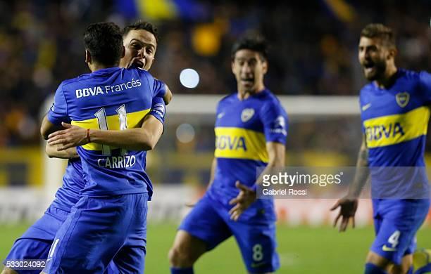 Leonardo Jara Federico Carrizo of Boca Juniors and their teammates celebrate after winning a second leg match between Boca Juniors and Nacional as...