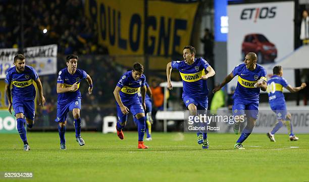 Leonardo Jara of Boca Juniors and his teammates celebrate after defeating Nacional in a penalty shootout during a second leg match between Boca...
