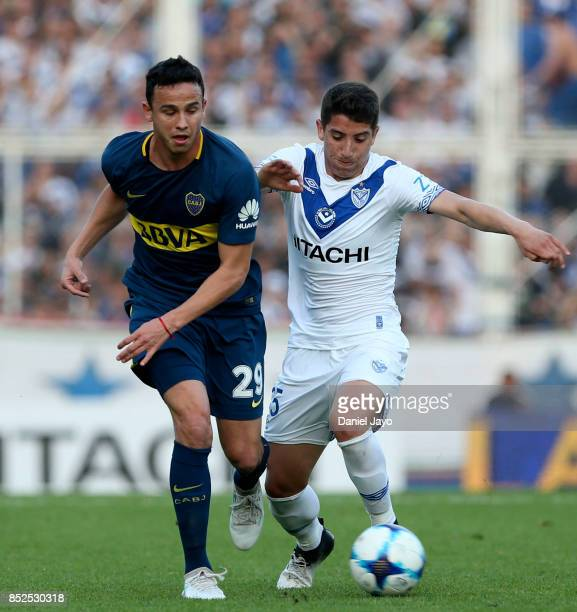 Leonardo Jara of Boca Juniors and Santiago Caseres of Velez Sarsfield vie for the ball during a match between Velez Sarsfield and Boca Juniors as...