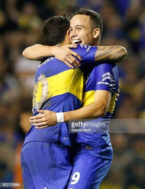 Leonardo Jara of Boca Juniors celebrates with Carlos Tevez after scoring the fifth goal of his team during a match between Boca Juniors and Deportivo...