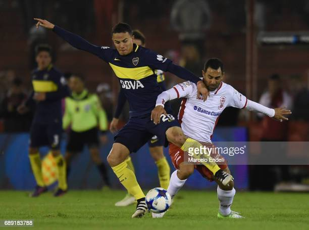 Leonardo Jara of Boca Juniors fights for ball with Daniel Montenegro of Huracan during a match between Huracan and Boca Juniors as part of Torneo...