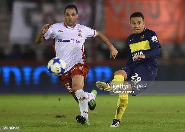Leonardo Jara of Boca Juniors fights for ball with Mariano Gonzalez of Huracan during a match between Huracan and Boca Juniors as part of Torneo...