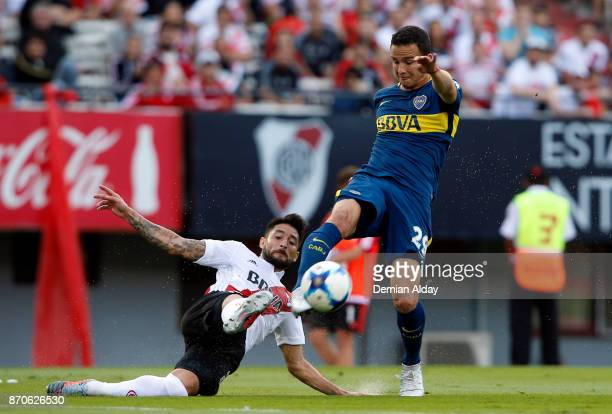 Leonardo Jara of Boca Juniors fights for the ball Milton Casco of River Plate during a match between River Plate and Boca Juniors as part of the...