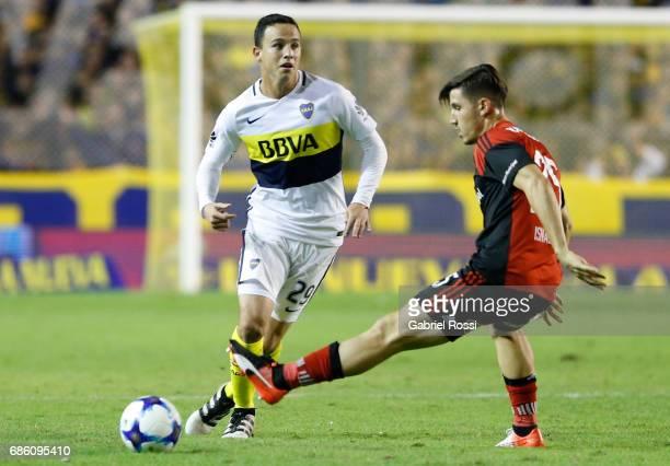 Leonardo Jara of Boca Juniors fights for the ball with Eugenio Isnaldo of Newell's Old Boys during a match between Boca Juniors and Newell's Old Boys...