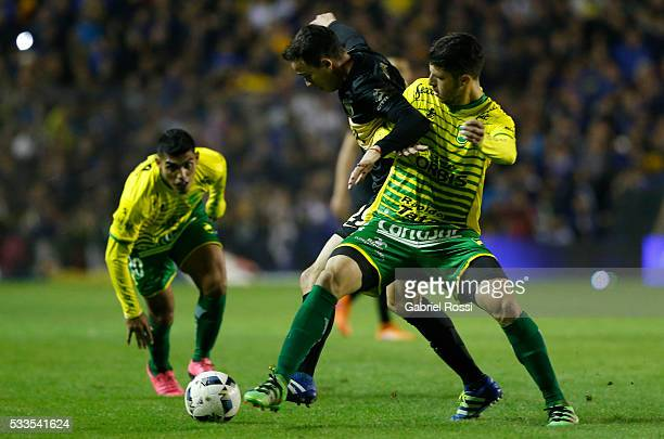 Leonardo Jara of Boca Juniors fights for the ball with Guido Rodriguez of Defensa y Justicia during a match between Boca Juniors and Defensa y...