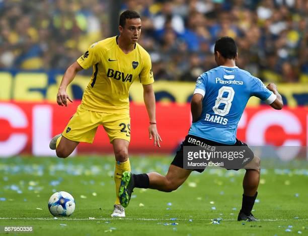 Leonardo Jara of Boca Juniors fights for the ball with Jonathan Ramis of Belgrano during a match between Boca Juniors and Belgrano as part of...